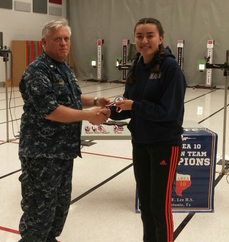 Commander Hale presenting the first place medal to Jasmine at the competition.