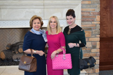 "Pictured at last year's ""Open Your Purse For Change"" are event chair and MCWC board member Ally Seder (center) with co-chairs Terry Larson (left) and Shirelle Chimenti (right)."
