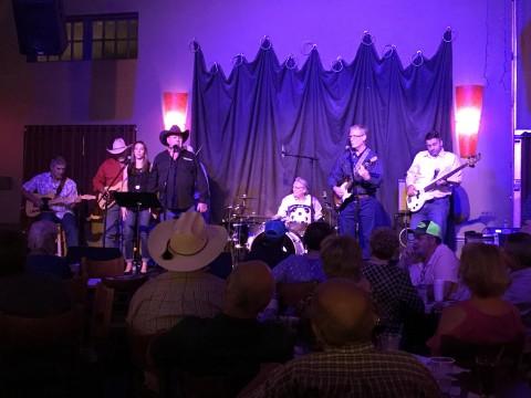 Charlie Riley band performing at Main Street Crossing.