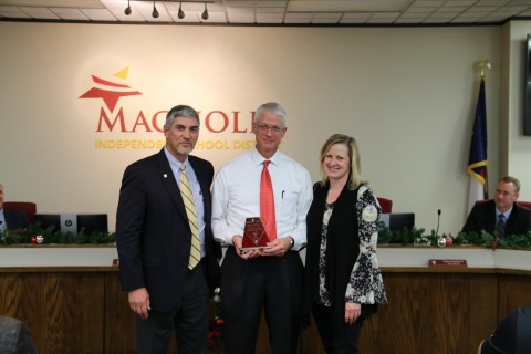 Superintendent Dr. Todd Stephens with Glenn and Lorie Addison.