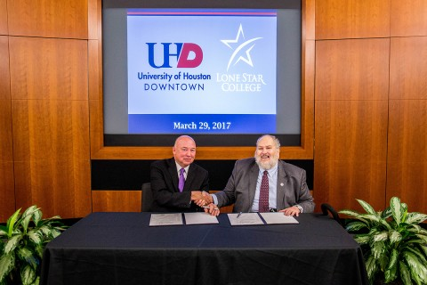 Lone Star College and the University of Houston-Downtown have expanded their relationship to make it easier for students interested in transferring between the two institutions. Pictured are Stephen C. Head, Ph.D., LSC chancellor, left and Dr. Michael A. Olivas, UHD interim president.