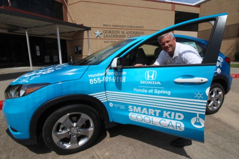 Honda of Spring General Manager Chuck Jett displays the 2018 Smart Kid Cool Car.