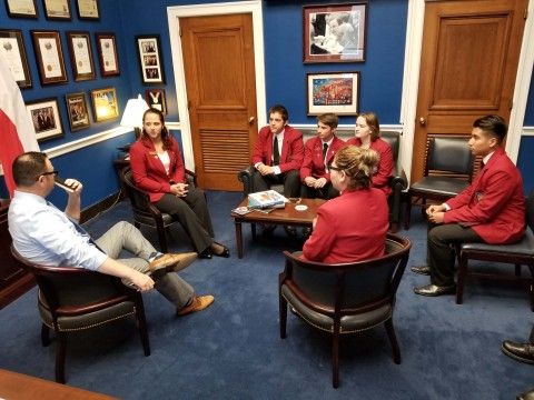 SkillsUSA members conducting a meeting with Christopher D. Taylor, assistant to Bill Flores, about the possibility of reauthorization of the Carl D. Perkin's Act of 2006.