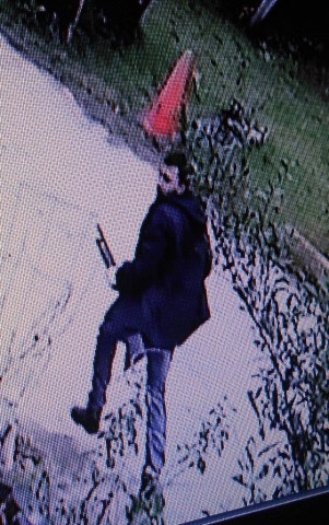 A photo of one of the suspects police hope to identify.