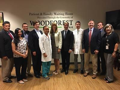 L-R Dr. Edward Escobar, Dr. Divya Chirumamilla, Dr. Randall Wright, Dr. Ryan McDonald, Dr. Geoffrey Zubay, Cathy Nash, president and CEO of Woodforest National Bank, Josh Urban, senior vice president and CEO of Memorial Hermann The Woodlands Medical Center, Dr. Sebastian Herrera, Dr. Kevin Gaffney, Dr. Christopher Langan, Dr. Sharon Brown