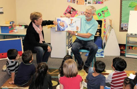 Montgomery County United Way board member, Lucinda Owen and former board member, Bob Evans, reading to children at Willis Head Start.
